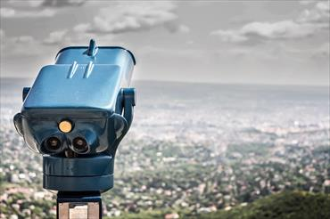 Image of coin operated binoculars overlooking the city below